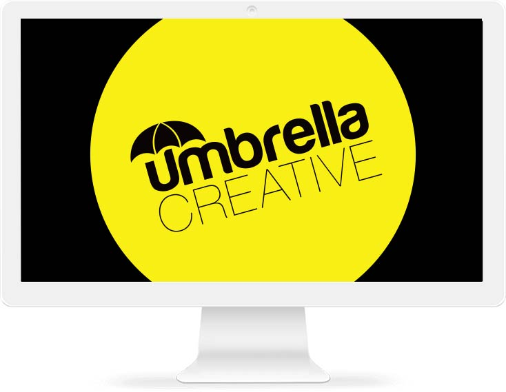 Umbrella Creative logo design displayed on a Mac monitor