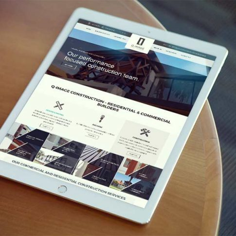 Q Image Website Design Displayed on a Tablet