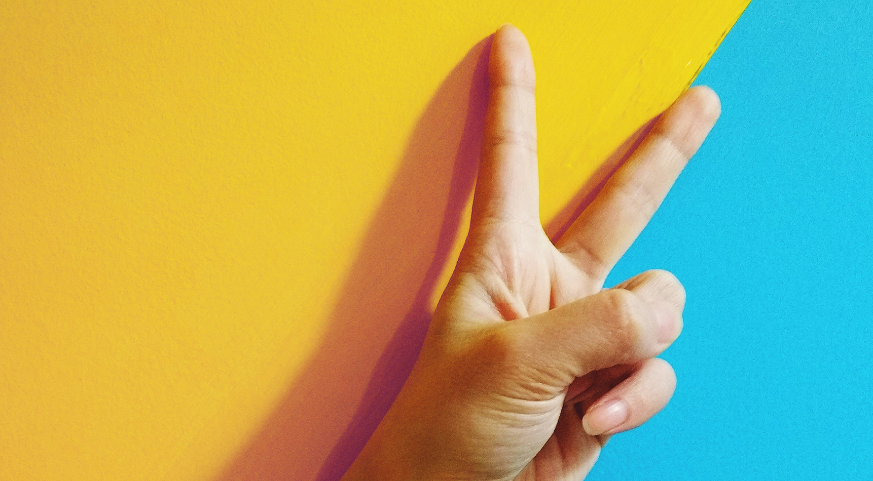peace sign on blue and yellow background | creative and professional webdesign brisbane