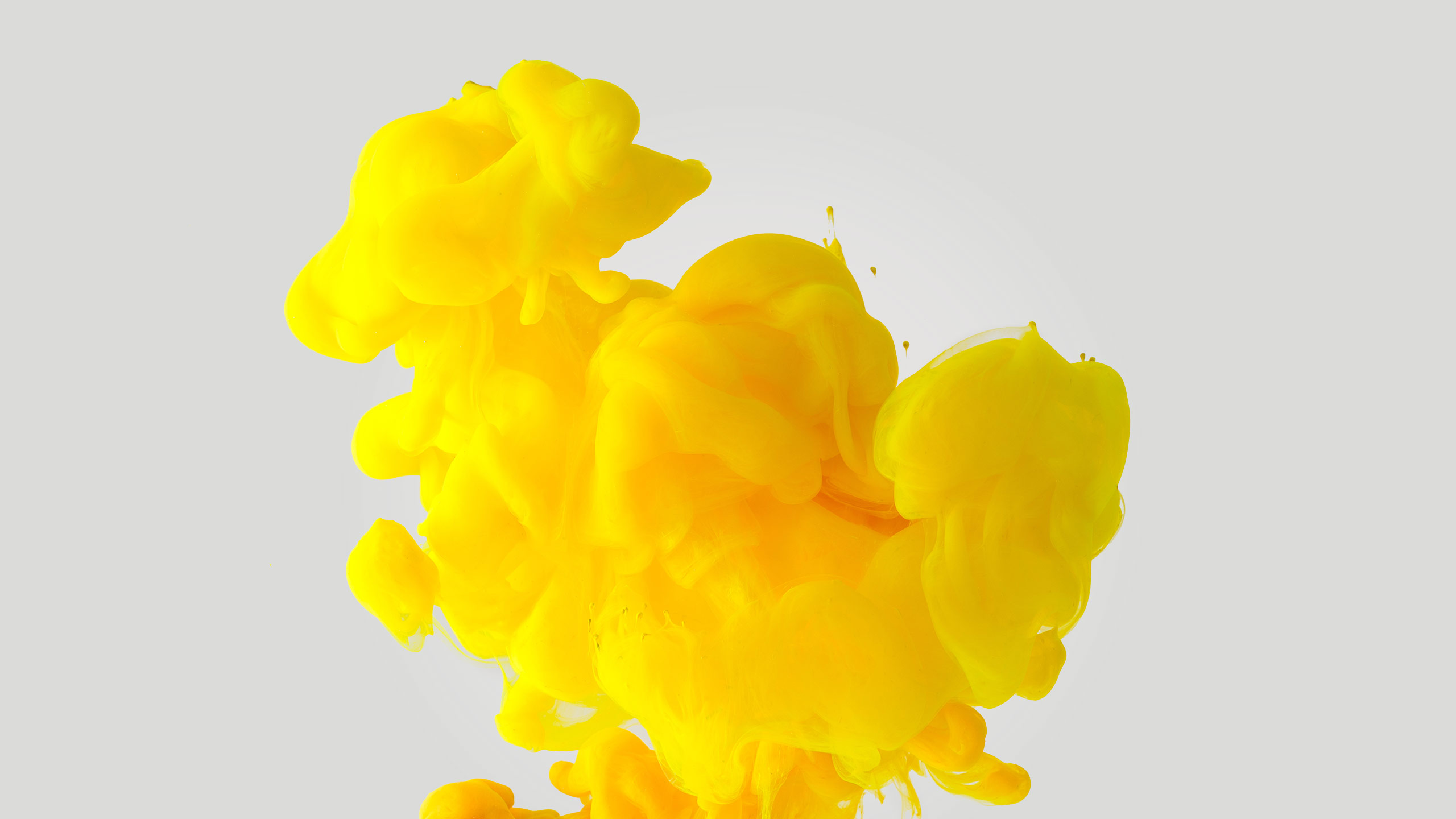 Cloud of bright yellow ink floating on a white background | Graphic Design Brisbane